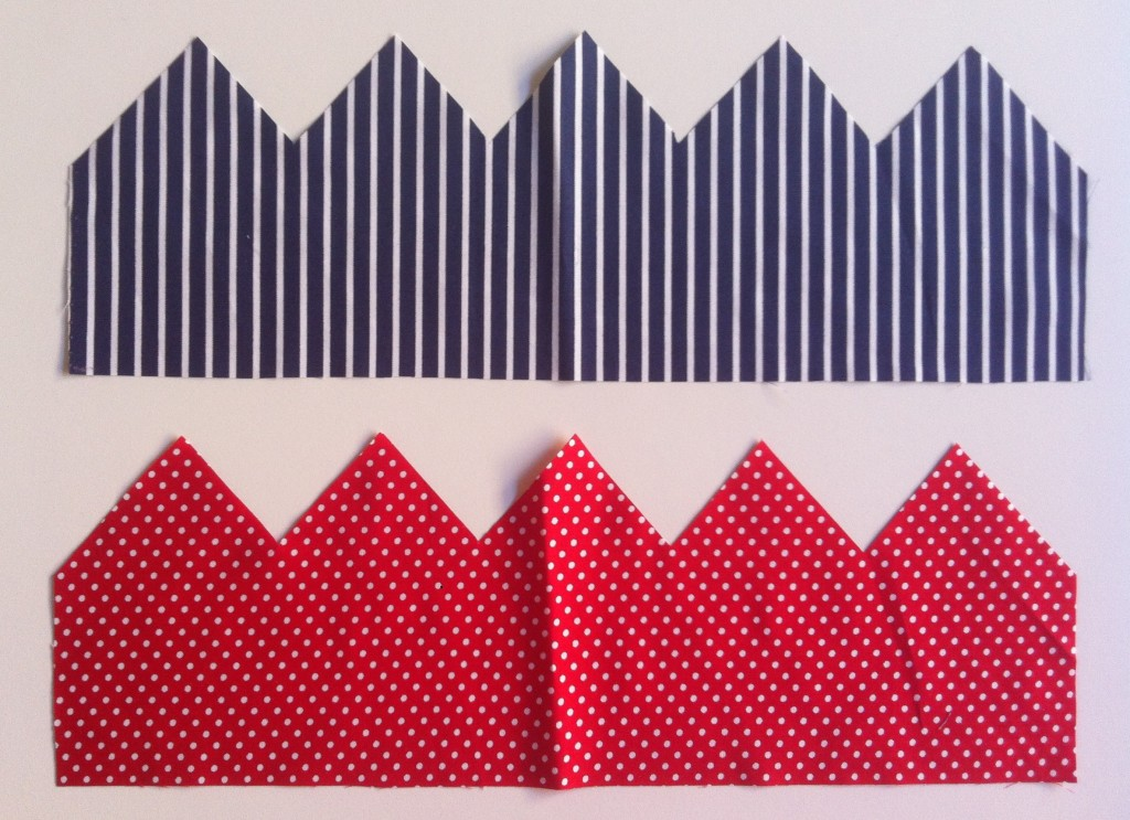 Cut out crown shapes in blue and white stripe and red polka dot fabric