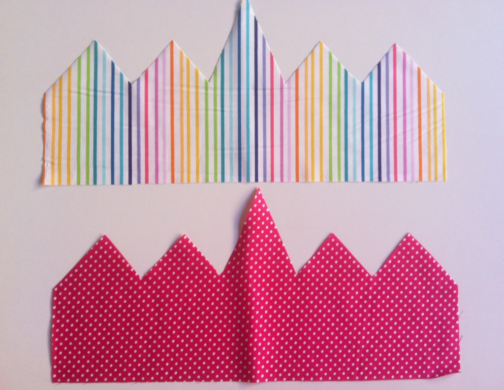 Cut out crown shapes in multi coloured stripes and pink with white polka dot fabric